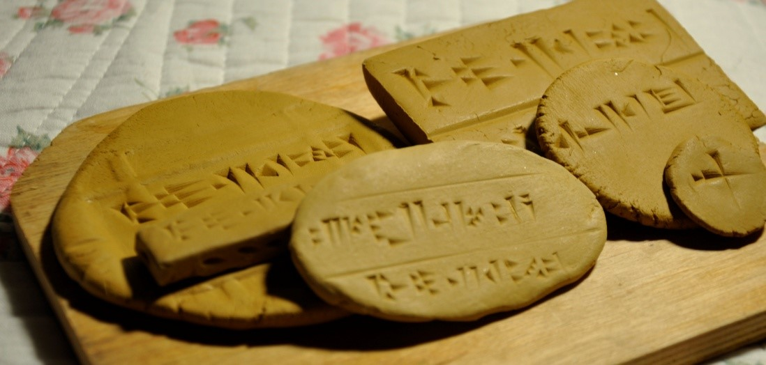 student follows the scribal tradition of creating different shapes and sizes of clay tablets