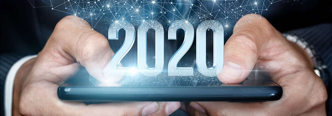 image of hands holding a mobile phone flat with graphic of 2020 floating above the phone