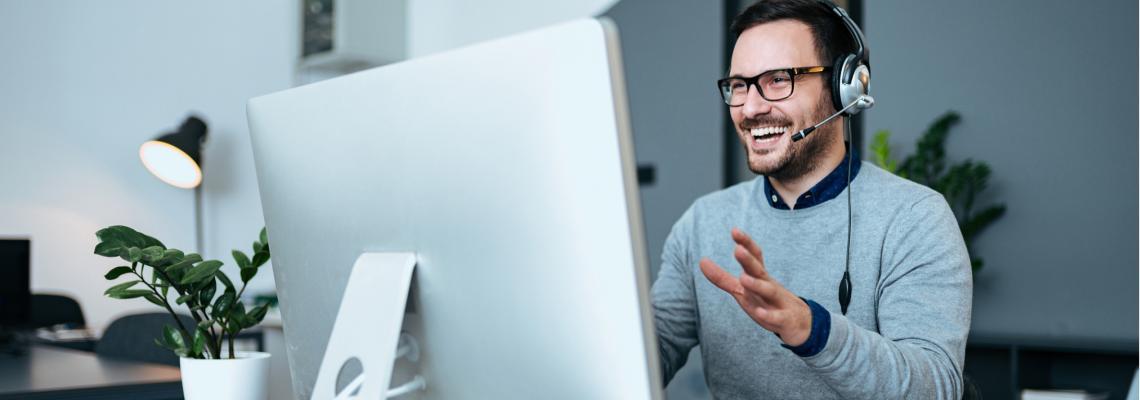 Page header image. Man looking at computer screen.