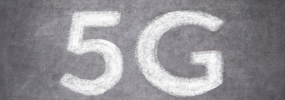 Closeup image of 5G written in chalk on a blackboard