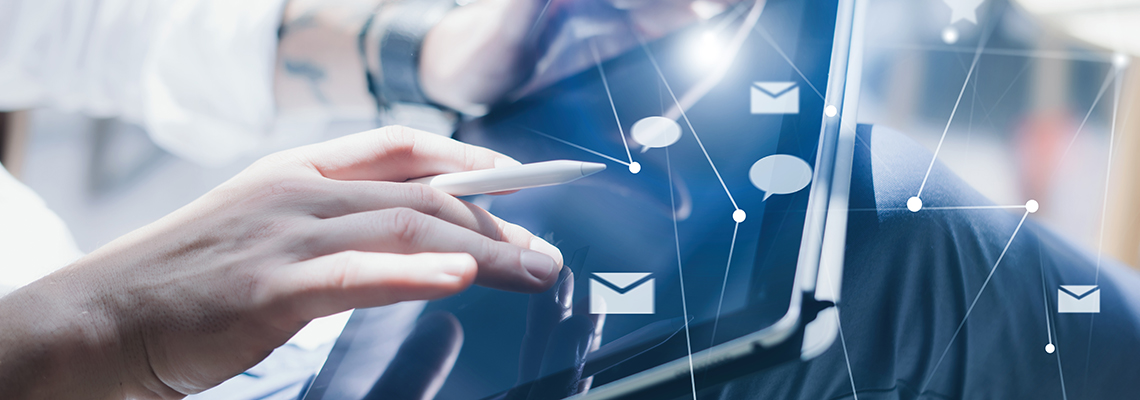 image of a hand touching a tablet overlaid with mail and callout icons