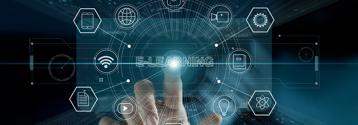 Image of a finger pressing on a see-through screen with the word E-Learning at the centre and icons surrounding it